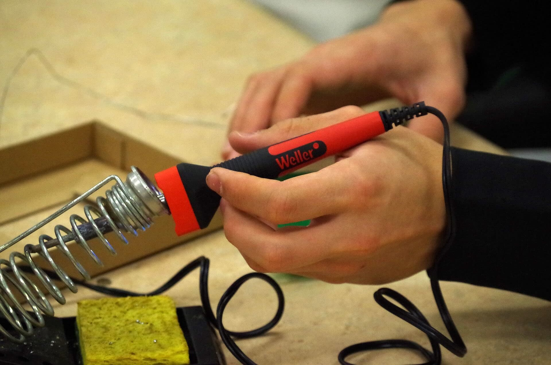 Technician using a soldering iron