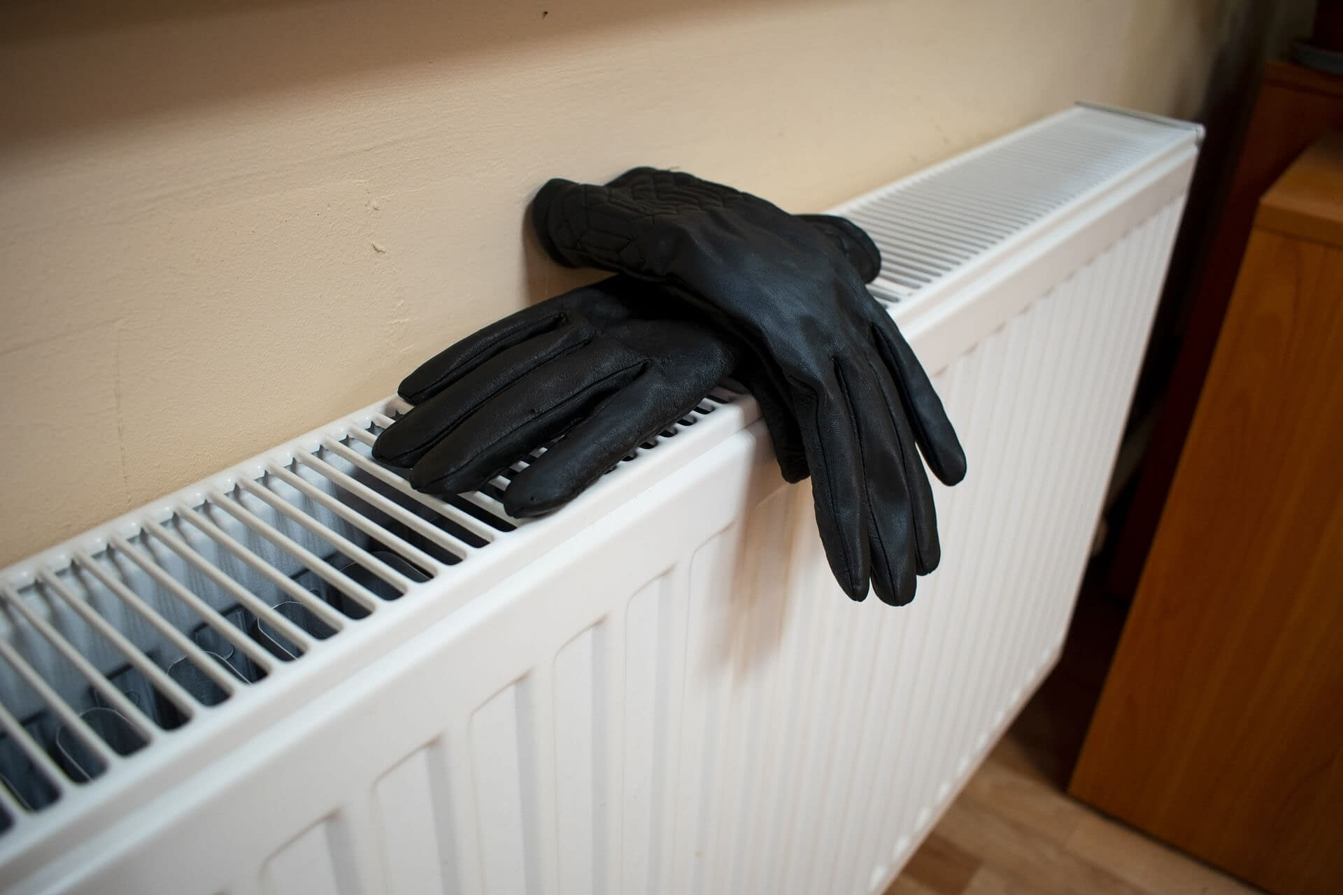 Heater with gloves on it
